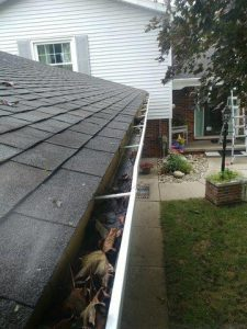 Leaves And Debris Sit In These Unprotected Gutters